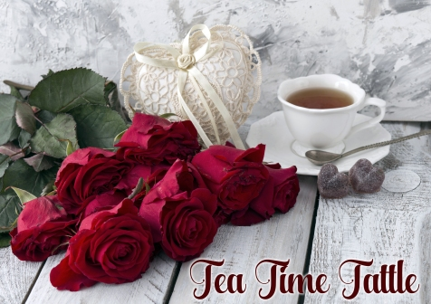 on a white wooden table red roses, cup of tea, heart made of lac